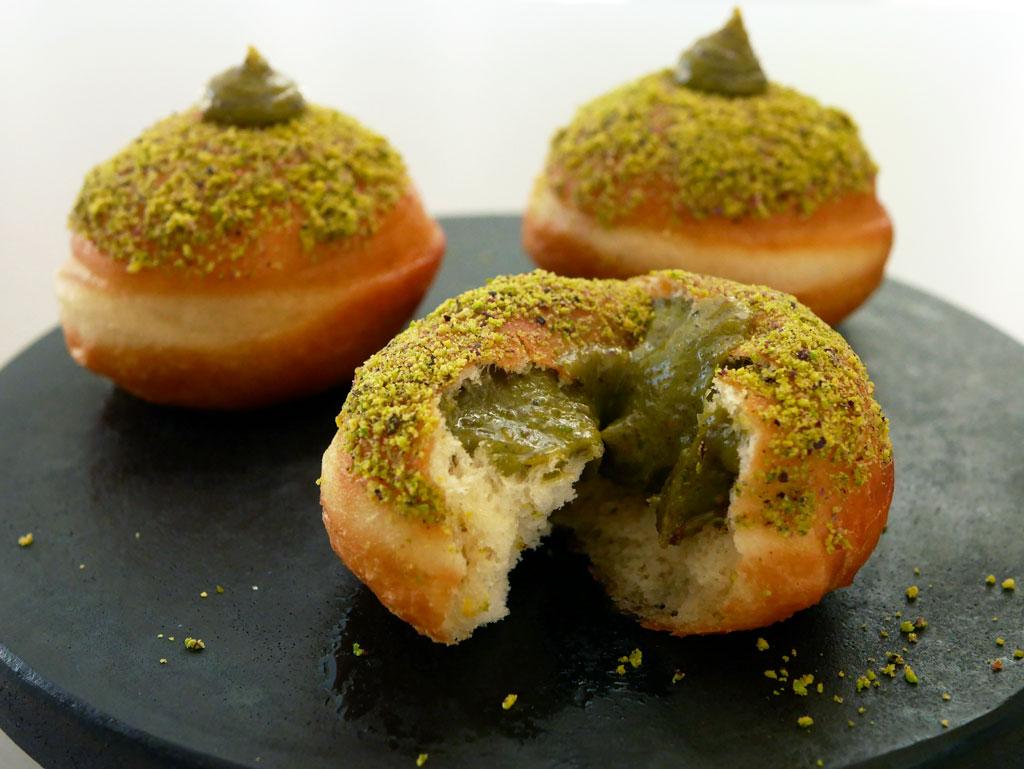 Lemon pistachio sufganiot